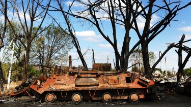 A destroyed armoured vehicle from a battle outside of the battered city of Luhansk on September 13.