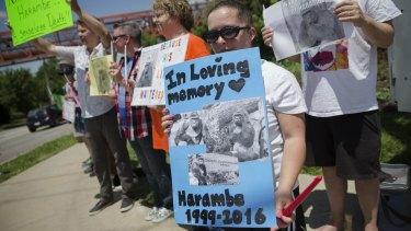 Kate Villanueva of Erlanger, Kentucky holds a sign during a vigil outside the Cincinnati Zoo.