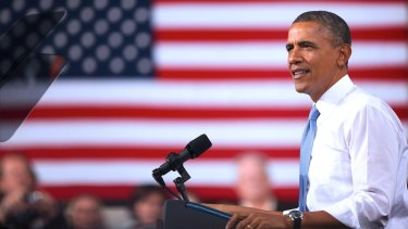 Jacketless, sleeves rolled up, Obama again defies political convention - even while at one.
