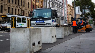 Temporary concrete bollards were installed around Federation Square on Saturday.