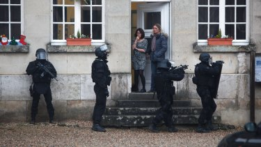 French SWAT officers on patrol near Longpont, north-east of Paris.