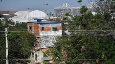 The last original house standing in Vila Autodromo, Olympic Park visible behind it.