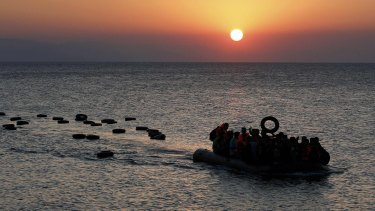 A dinghy overcrowded with Syrian refugees approaches a beach on the Greek island of Kos after crossing part of the Aegean Sea on Thursday.