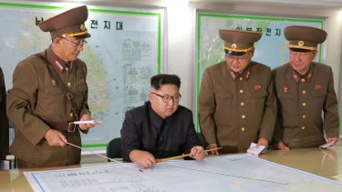 Kim Jong-un talks with military commanders during his visit to Korean People's Army's Strategic Forces in North Korea on August 14.