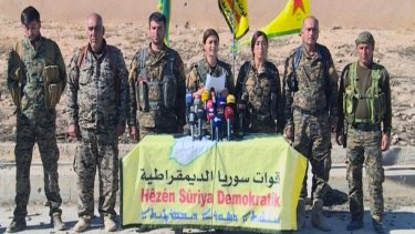 The US has backed Kurdish forces in Syria, seen here giving a press conference.