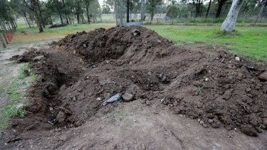 Asbetos was also found in the mass grave site.