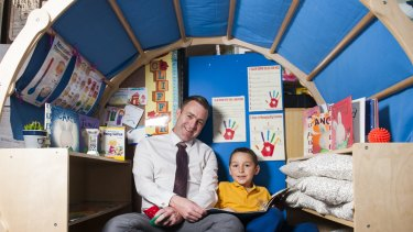 Theodore Primary School principal Matt Holdway with student Will Bourke in a sensory igloo.