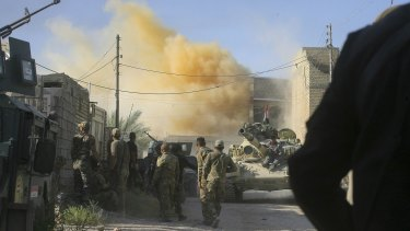 Smoke rises after an airstrike as Iraqi security forces advance.