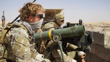 Belgian special forces soldiers sit on a rooftop with a guided-missile launcher, a few kilometres east of Tal Afar, Iraq, earlier this month.