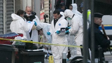 Forensics officers outside 8 Rue du Corbillon in Saint-Denis, Paris, on Wednesday. The bodies of Abdelhamid Abaaoud and Hasna Aitboulahcen have been identified.