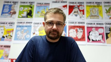 Killed by gunmen ... Charlie Hebdo's publisher and editor Stephane Charbonnier in 2012. A 24-year-old man faced trial for allegedly threatening to behead Charbonnier in September, 2012.