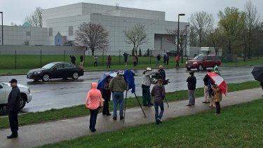 A crowd gathers outside Paisley Park as news of Prince's death spread.