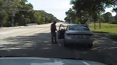 The officer opens the driver's side door as he orders Sandra Bland out of her vehicle, in this still image from the police dash camera video that recorded the traffic stop.