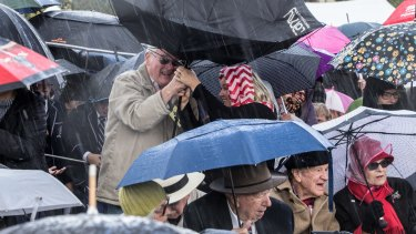 Torrential ran sweeps an Anzac commemoration.