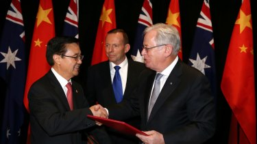 Chinese Commerce Minister Gao Hucheng, left, Prime Minister Tony Abbott and Trade Minister Andrew Robb at the signing ceremony for the China-Australia Free Trade Agreement in Canberra in June.