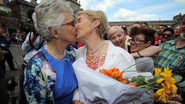 Irish senator Katherine Zappone (left) kisses her partner Ann Louise Gilligan at the Dublin Castle celebration.