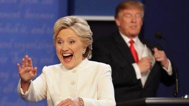 Hillary Clinton waves as Donald Trump puts away his notes at the third presidential debate.