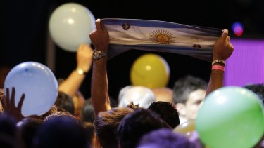 Supporters of opposition presidential candidate Mauricio Macri celebrate preliminary results  in Buenos Aires on Sunday.