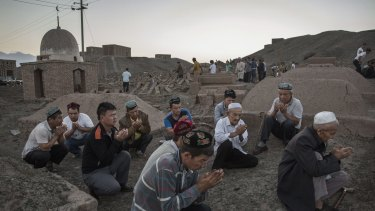 Uighur men perform prayers for the Islamic festival of Eid al-Adha in Turpan County, Xinjiang, in September.
