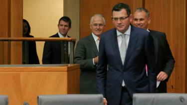Daniel Andrews emerges to face the press alongside other state and federal leaders.