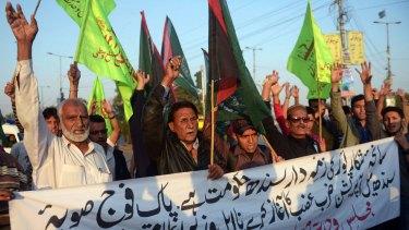 Pakistani Shiite Muslims in Karachi protest the attack.