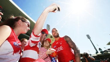 Lance Franklin of the Swans with fans during a Sydney Swans AFL training session.