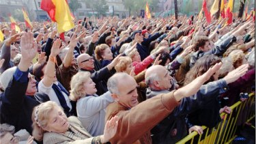 Right-wing Spaniards make the fascist salute at a rally in Madrid in 1995 as they commemorate the 20th anniversary of the death of Spain's dictator Francisco Franco.