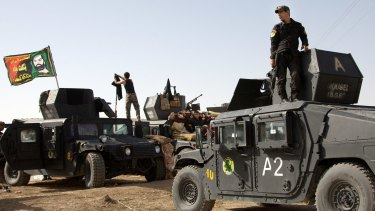 Iraqi special forces soldiers deployed to retake Mosul from Islamic State militants are working in a joint effort with allied militias, some US ground troops and with US-led coalition aircraft providing support.