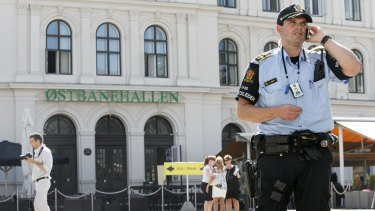 Armed police stand guard at the central railway station in Oslo after of a possible terrorist threat in July 2014.
