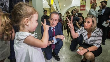 Bill Shorten meets two-year-old Isabella Roberts at Morayfield Shopping Centre.