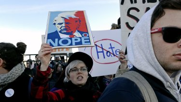 Protesters march in Chicago before a rally with Republican presidential candidate Donald Trump.