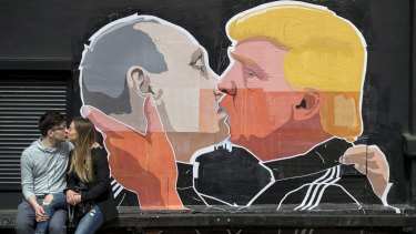 A mural on the walls of a bar in Vilnius, Lithuania, depicts Russian President Vladimir Putin and Republican President-elect Donald Trump kissing.
