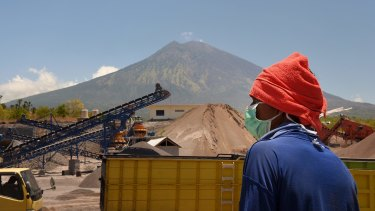 Inside the exclusion zone, day labourers works at the PT Bhale Dana mine in Kubu, at the base of Mount Agung in Bali.
