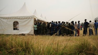 Burundian police and soldiers vote at a polling station this week.