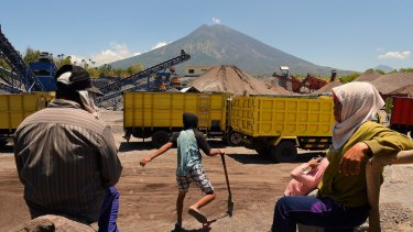 People living and working within 12 kilometres of the volcano have been told to evacuate, but the PT Bhale Dana mine is still operating.