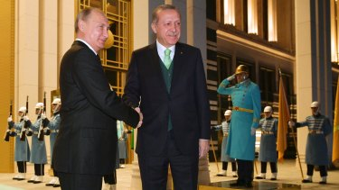 Vladimir Putin, left, shakes hands with Recep Tayyip Erdogan prior to their meeting at the Presidential Palace in Ankara, Turkey, on Monday.