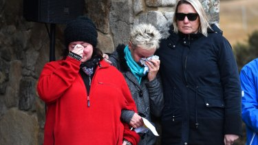Mourners Donna Barlow (L) and Wendy Hukins (C) at a memorial service at the Thredbo Ecumenical Chapel on Sunday.