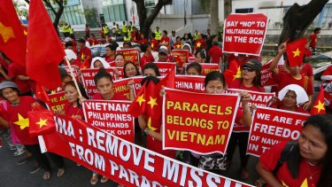 Filipinos and Vietnamese expatriates rally last Thursday at the Chinese consulate in Makati, east of Manila, to protest China's island-building and deployment of surface-to-air missile system in the South China Sea.