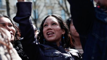 A sex worker shouts slogans during a protest against a new law that targets the clients of prostitutes.
