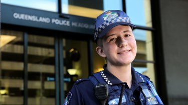 """Transgender police officer Mairead Devlin, 22, said he was """"humbled"""" to raise the flag and had been overwhelmed by the support within QPS for his gender transition."""