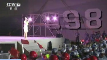 A singer performs for Chinese navy officers and construction workers on Fiery Cross Reef in the South China Sea.