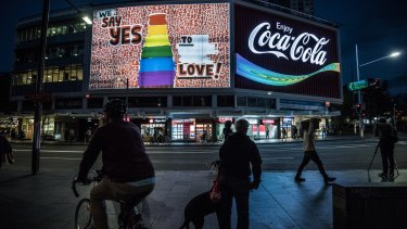 The Coca-Cola sign in Kings Cross has been changed to show support for same-sex marriage.