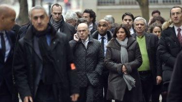 Fench Interior Minister Bernard Cazeneuve and Paris Mayor Anne Hidalgo arrive at the scene.