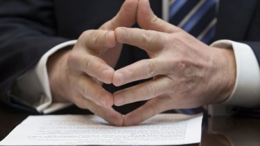 The hands are made for cutting. Donald Trump rests his hands on notes during a meeting in the Roosevelt Room of the White House.