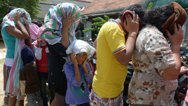 Sri Lankan asylum seekers sent back by Australia in July enter court in Galle, Sri Lanka.