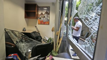 The Thai consulate in Istanbul on Thursday, damaged by a group of protesters who stormed the building, smashing windows and breaking into offices, where they destroyed pictures and furniture and hurled files out into the yard.