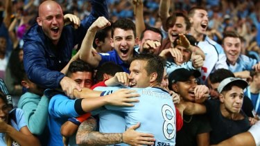Seeing blue: Sydney FC fans celebrate Corey Gameiro's opener against Melbourne City last weekend.