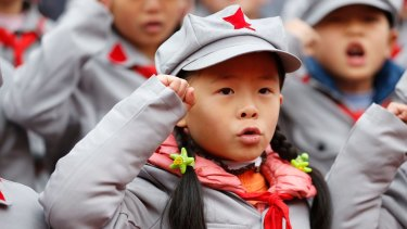 Young Chinese students dressed in Red Army costumes at a school ceremony in Gulin county, Luzho, Sichuan province.