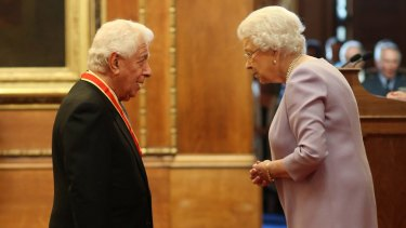 Sir Frank Lowy AC, during his investiture by the Queen at Windsor Castle last week.