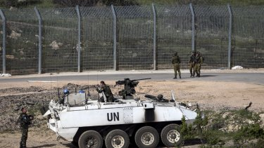 Israeli soldiers and members of UN peacekeeping forces near the frontier with Syria on Monday.
